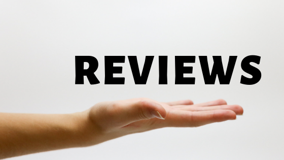Hand holding Reviews word